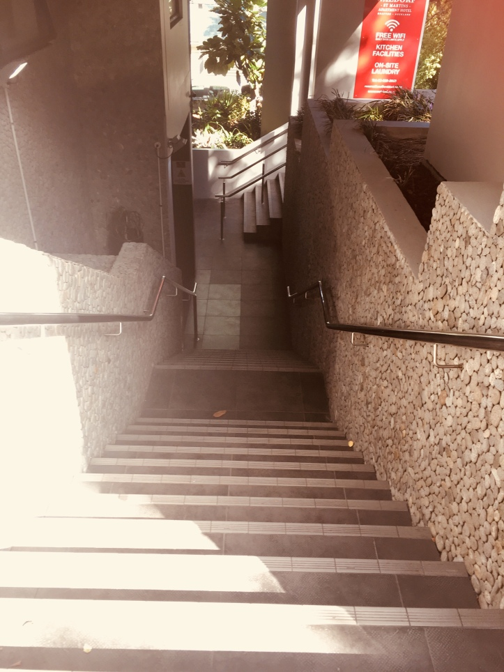 Staircase to the reception of our apartment...intriguing especially since it is right next to a cementary